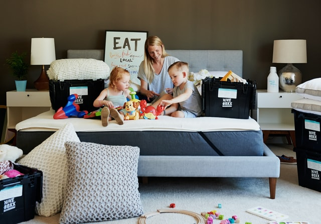 Kids packing stuff with their mom -The Ultimate Guide to Moving With Toddlers