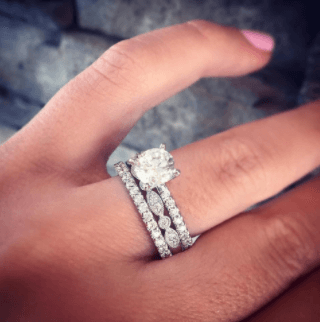 Engagement Ring on top of Wedding Ring
